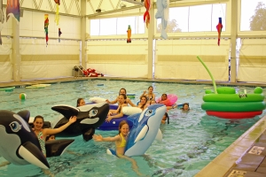 Children having fun at a child's birthday party hosted in our indoor pool!